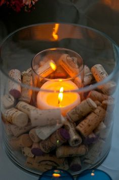 Fill Glass Containers with Wine Corks -- perfect for dining room table centerpiece.