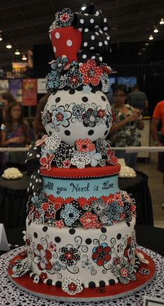 fabulous red, black, white and pale blue cake with tons of fun flowers