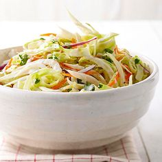 This Creamy Cabbage and Fennel Coleslaw makes the perfect dinner side dish! More healthy potluck recipes: http://www.bhg.com/recipes/party/party-ideas/heart-healthy-potluck-recipes/?socsrc=bhgpin082313coleslaw=18