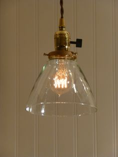 Brass Pendant Light with Hand Blown Clear Glass Funnel Shade. $88.00, via Etsy.
