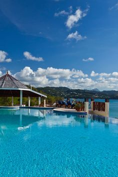 Perched on a tropical hillside that slopes gently toward the sea, Saint Lucia's Calabash Cove Resort and Spa offers a truly heavenly setting for your destination wedding. #AskMeDestinationWeddings