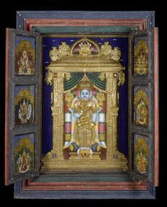 """A large mid-19th century hanging temple cabinet, the interior depicting Vishnu within an ornate alcove in relief, Tanjore, South India  gouache and gold on board, the interior of the doors with six panels each depicting other Hindu deities, all enclosed within a painted wood cabinet, the exterior of the doors depicting a further four deities, gouache on wood within recessed panels, 169cm wide x 50cm deep x 228cm high, (66.5"""" wide x 19.5"""" deep x 89.5"""" high)"""