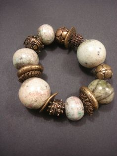 Bracelet with ceramic beads and metal rings by Razelle Troester