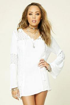 A woven shift dress by Boho Me™ featuring long bell sleeves, a self-tie split neckline, and crochet panels throughout.