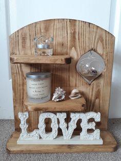 Pallet wood shelf with hanging glass vase
