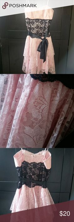 Knee length formal dress Blush sparkly lace and satin bow. Adjustable straps. Zipper back. Layered skirt. Only worn once for a couple hours. It has been stored in the bag from the store ever since. Deb Dresses Prom