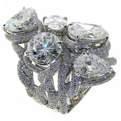 Different shapes of Diamonds branching out, set in white gold.