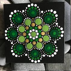 For sale is a hand-painted Mandala on a 4x4 canvas. Painted with high-quality acrylic paints, with a gloss acrylic finish for protection. Colors in this Mandala are Green & Gold. Each one is hand made and no two are alike