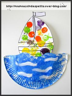 Paper plate ocean with a sailboat