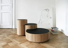 Dan Yeffet and Lucie Koldova have designed a new series of coffee tables, consisting of three low tables with base in solid oak and glass satin tabletop, available in either white or black edition.