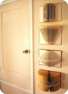 Add Dimension And Color To Your Home With 3D Wall Art Not all 3D wall art has to be colorful. Sometimes the meaning lies beyond that. Here's some unique wall art made from actual books. You basically take an old book and fold or trim the pages so they form these interesting shapes.{found on etsy}.