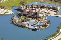 Two pools, a water slide, and a luxury community clubhouse on an island are the centerpiece of the Savannah new home community in Aubrey, Texas.