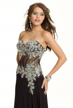 Sweetheart neckline, heavy flower beaded bodice, and an illusion corset