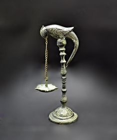 Made of cast metal (dhokra) - unknown metal, but does not hold a magnet. Bird holding chain attached to receptacle for oil. True age unknown, but does show some wear and much patina (we do not clean metal items). Vintage Birds, Vintage Wood, Vintage Art, Diya Lamp, Wood Framed Mirror, How To Clean Metal, Jelly Jars, Horse Sculpture, Ginger Jars