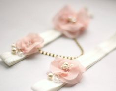 Blush pink garters, a true glimps of romance to complete your wedding attire. These hand dyed chiffon shabby chic flowers are adorned with pearls,