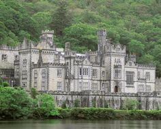 KYLEMORE BENEDICTINE ABBEY, Connemara, County Galway, Ireland. Originally built as a castle residence, it was designed by James Franklin Fuller & Ussher Roberts. Construction first began in 1867, and took one hundred men four years to complete. The castle covers approximately 40,000 square feet (3,700 m2) with over 70 rooms and the principal wall is two to three feet thick. The abbey was founded in 1920 for Benedictine Nuns who fled Belgium in World War I. ~Wikipedia