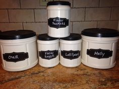 Foldgers coffee containers, spray painted antique white with chalk board labels!