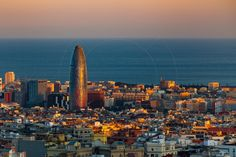 Torre Agbar and Cityscape Barcelona Catalonia Spain  http://www.alamy.com/mediacomp/imagedetails.aspx?ref=FY3FRJ agbar architecture attraction barcelona blue building built business catalonia city cityscape destinations district downtown dusk ellipse europe european exterior famous high landmark mediterranean night office oval panoramic place scene sea