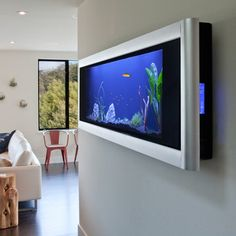 Panoramic Aquarium 24x70 Silver  by Aquavista   Create a visually dynamic focal point in your home with this work of living art. The silver Panoramic Wall Aquarium looks like a plasma television but contains a low-maintenance beatific underwater world. Ideal for fresh water tropical fish—it even includes an automatic feeder. Simply hang, add water and fish and create your compact aquatic paradise.