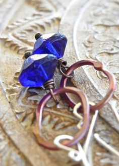 The Ultramarine earrings - amazing cobalt (vintage) trade beads are combined with artisan made rosy copper elongated rings, blackened copper head pins, and my hand forged bright sterling silver ear wires.