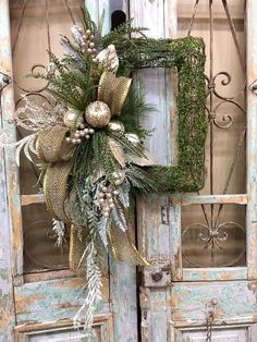Christmas wreath christmas door decor christmas decor all of our door wreaths door swags are designed with the highest quality in season ribbon and florals market has to offer ▪️base rectangle moss wreath ▪️ribbon d stevens 4 gold ▪️florals platinum fruit Christmas Door Decorations, Christmas Swags, Noel Christmas, Christmas Centerpieces, Holiday Wreaths, Rustic Christmas, Christmas Ornaments, Christmas Floral Arrangements, Christmas 2019