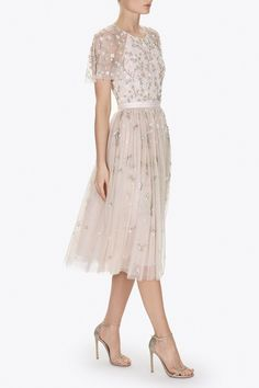 UK EXCLUSIVE: The Starlit midi dress is decorated with a delicate, scattering embellishment, which was inspired by Victorian Floral Lace. The florals are depicted in iridescent, silver and gold components which add a beautifully subtle, all-over shimmer. The soft petal pink base compliments the pretty embellishment. The backless detail adds a feminine edge to this elegant tulle shape.