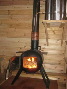 Homemade wood stove and hot water tank/pump. My husband could make this!