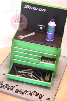A toolbox cake for the owner of a truck repair...