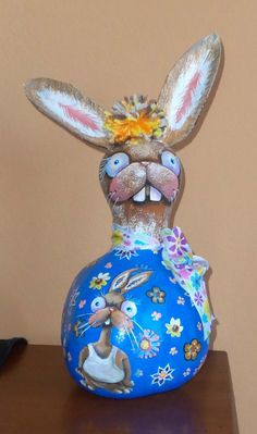 Crazed bunny (gourd) lady with laid-back nephew, created by Lola Stude