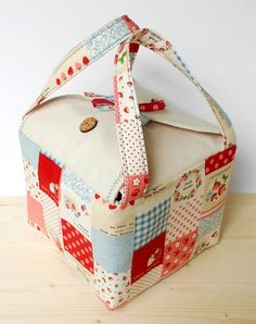 A handmade lunch bag or bento bag made of Japanese cotton with cute patchwork pattern, and round flaps embellished with cute strawberry shaped wooden buttons. Size (appx): 17cm(w) x 17cm(h) x 15cm(d) - body    We do our best to display the product with the actual color contrast. But due to different laptop or monitor, color may change slightly. -------------------------------------------------------------------------------------------    We accept custom made order and we provide wide range…