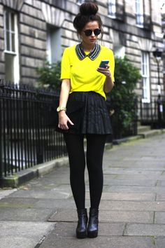 A perfect ensemble for fall or winter! Beautiful black pleated leather skirt with a neon yellow top and a fierce black platform boot.