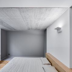 Settled away behind an uncompromising concrete wall is The Greywall House, located in the city of Vilnius, Lithuania. The outer shell crosses the thr...