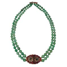 A Jadeite Bead Necklace with Rubies and Diamonds  Deccan, Mysore.  18th Century    A lovely necklace with a beautiful clasp set in rubies diamonds and a central emerald  and mounted on a double string of jadeite beads probably from a later date.  Clasp late 18th Century.