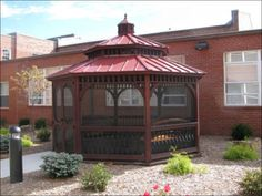 baroque style wood octagon gazebo with mahogany stain cupola screen package and standing seam metal pagoda roof - Screened Gazebo