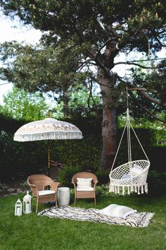 the balinese umbrella and macrame chair take this backyard setup to a whole other level!
