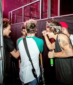 One Direction.   Umm, hello...    Harry's arm is HUGE!!!