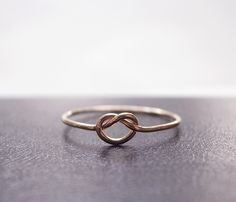 love this rose gold knot ring