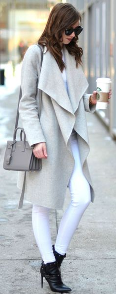 Barbora Ondrackova looks ultra sleek in this white jeans outfit consisting of a pale beige wrap coat and heeled ankle boots. These pieces make a winning combination which is perfect for a simple winter look! Top: Acne, Jeans: Mango, Coat: Zara, Bag: Saint Laurent, Boots: Valentino.... | Style Inspiration