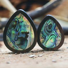 Hand made organic teardrop plug with abalone shell inlay. Delicately hand carved to the highest quality. All our plugs are tested and pass through strict quality control to ensure they're of the highest standard. Why not tag us in a photo of you wearing your products. Instagram: