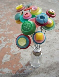 I've made these button bouquets for a few years now. They are made from vintage buttons & clustered into a vintage salt shaker. They were in...