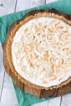 Gluten Free Vegan Coconut Cream Pie. Dreamy, creamy coconut pudding, topped with whipped coconut cream. Recipe found at Sarah Bakes Gluten Free!