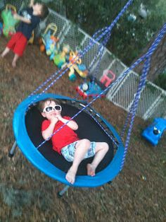 Turn an old mini trampoline into a swing. Or bury it for ground level jumping fun.