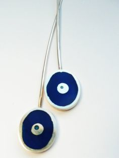 cast silver and royal blue resin drop earrings, made for my sister. by JRN