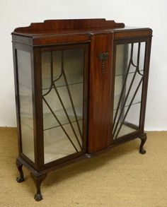 A 1930's walnut double display case with Art Deco sunburst This would make an amazing shoe display closet. Top of my wish list:)