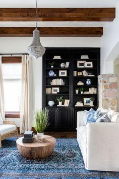 BECKI OWENS-Heber House Project Library a fresh rustic space- BM Swiss Coffee, BM Black Satin, Arteriors Jacob coffee table, Surya Zahra rug. Go to the blog for more details!