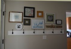 coat rack and uneven pictures for front room