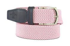 THE PAISLEY PINK | Add some fun to your closet with our Paisley belt. The navy leather trim and silver tone buckle add a sophisticated edge to the pastel pink woven elastic. #luxurygolf #luxurybelts #golfshoes #modernluxury #leatherbelts #wovenbelts