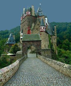 Eltz Castle (German: Burg Eltz) is a medieval castle nestled in the hills above the Moselle River between Koblenz and Trier, Germany. It is still owned by a branch of the same family that lived there in the 12th century, 33 generations ago. Information from: en.wikipedia.org/...