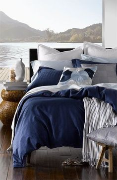 [Not real, I'd say, since nobody faces the bed away from the view.]  blue / bedroom / view