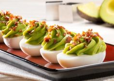 Avo Footballs | Avocados From Mexico  These football-shaped eggs are devilishly good, with a turf-colored filling.